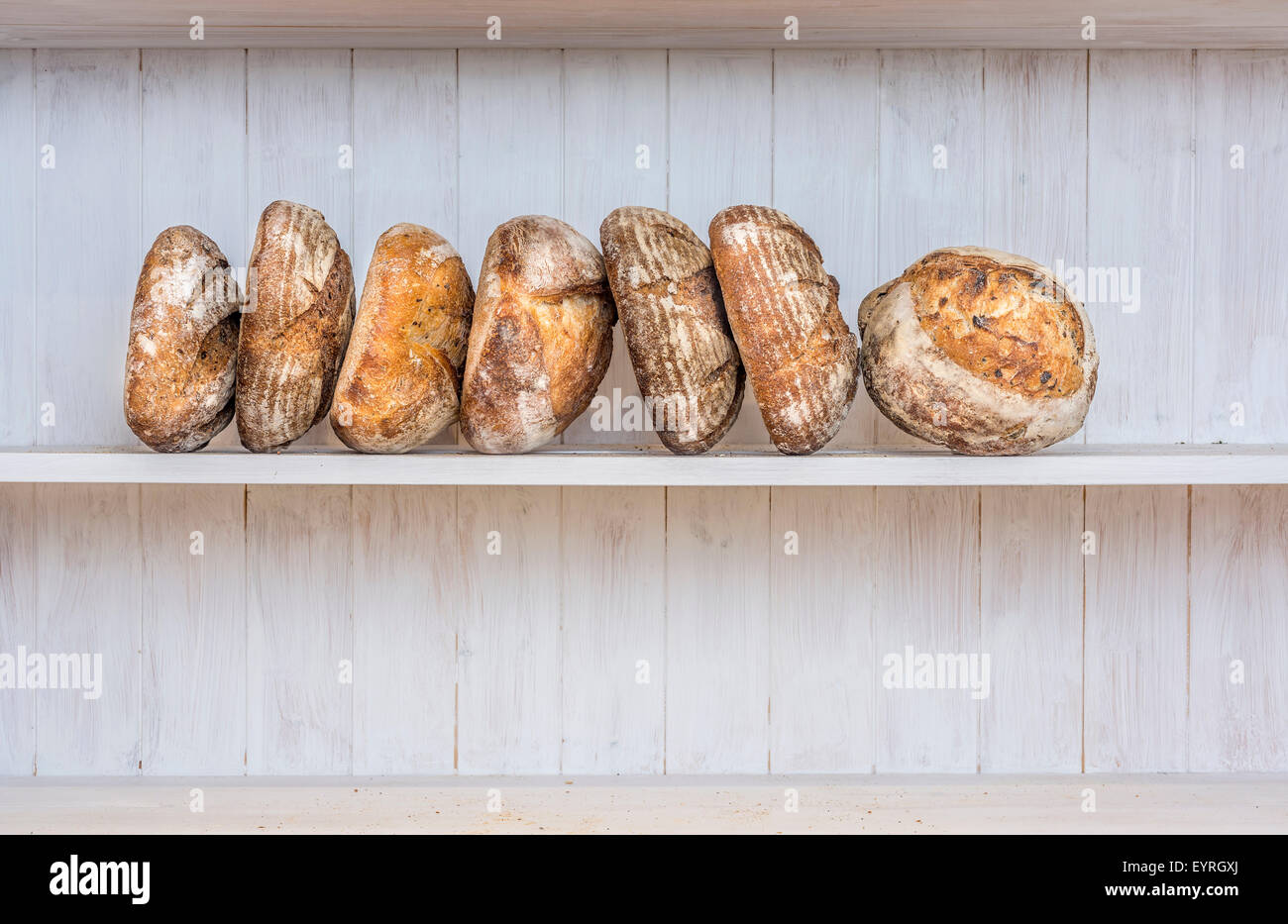 Various traditionally made sourdough breads in a bakery, Devon UK - Stock Image