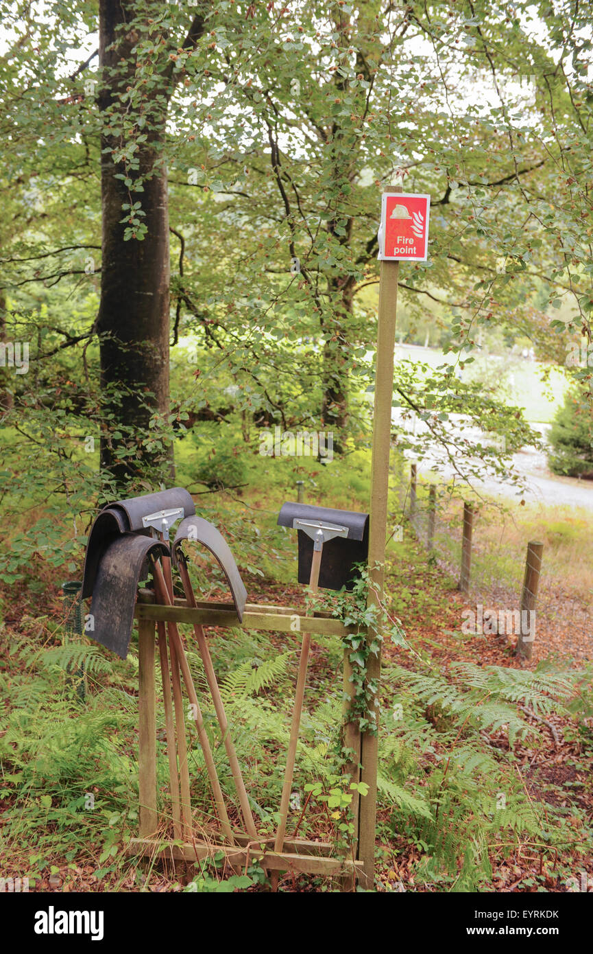 Fire Paddles and Fire Point Sign in Woodland at Rosemoor, near Torrington, in Devon, England, UK - Stock Image