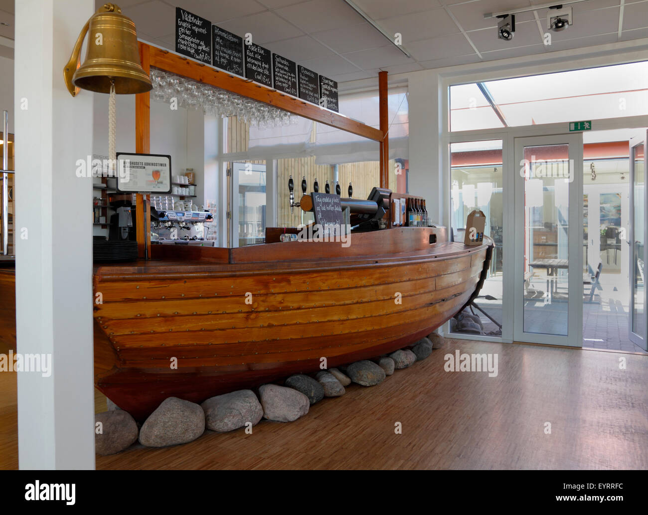 The bar formed by a viking-like boat at Halsnæs Bryghus, a local microbrewery on Hundested Harbour, Denmark - Stock Image