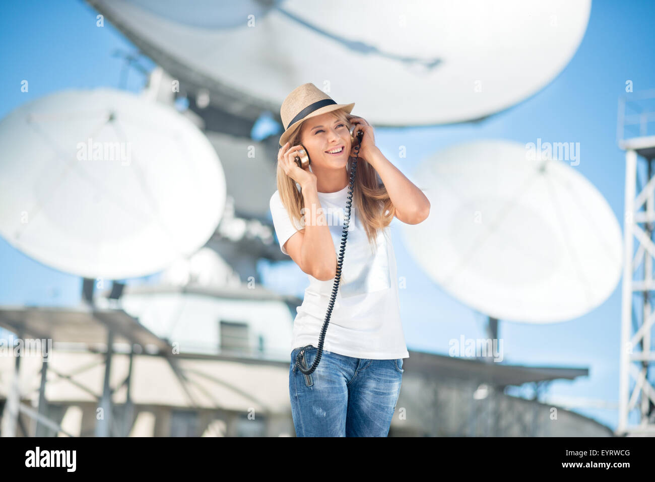 Happy young woman in hat listening to the music in vintage