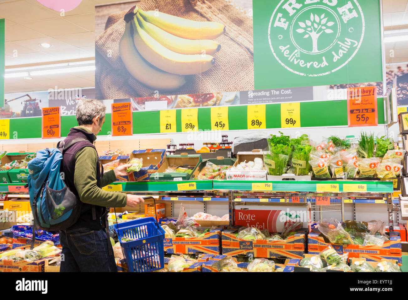 Man buying fruit and veg in Lidl supermarket. UK - Stock Image