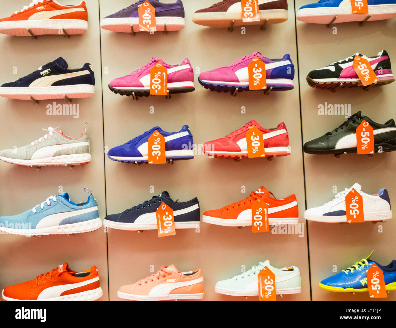 Puma training shoes display in sports store. - Stock Image 09df29451879