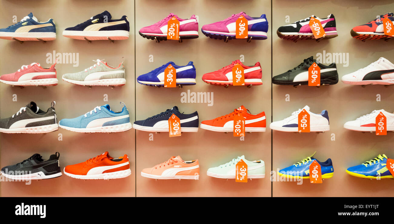 Puma training shoes display in sports store Stock Photo  85965344 ... 32515a6ae743