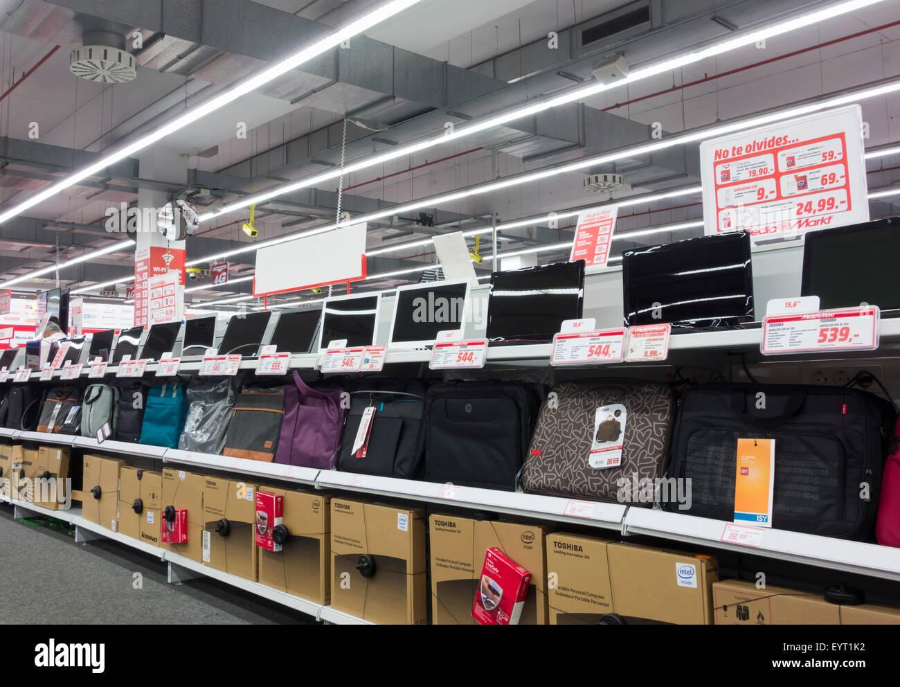 laptops display in media markt megastore in spain stock. Black Bedroom Furniture Sets. Home Design Ideas