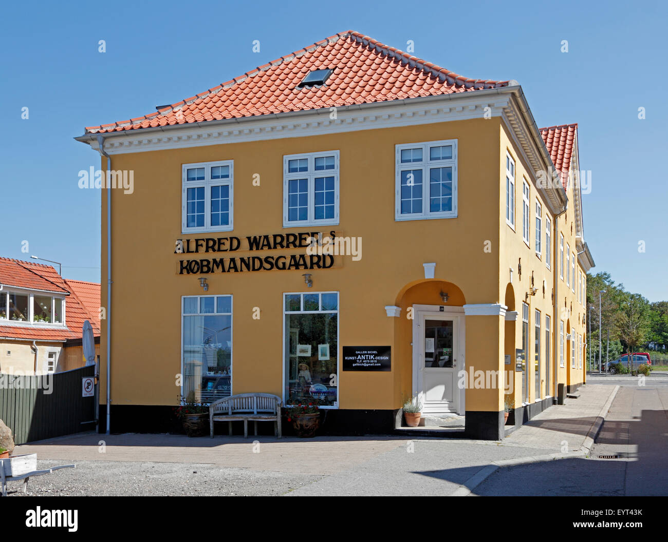 Old merchant's house with shop and adjoining building, now an antique shop, in Hundested, Zealand, Denmark - Stock Image