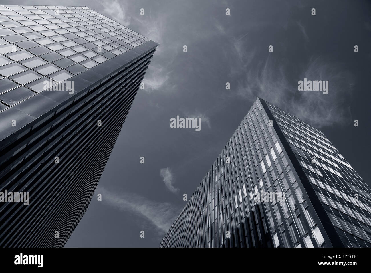 Blue-tinted black and white image of two identical skyscrapers, Germany, North Rhine-Westphalia, Dusseldorf - Stock Image