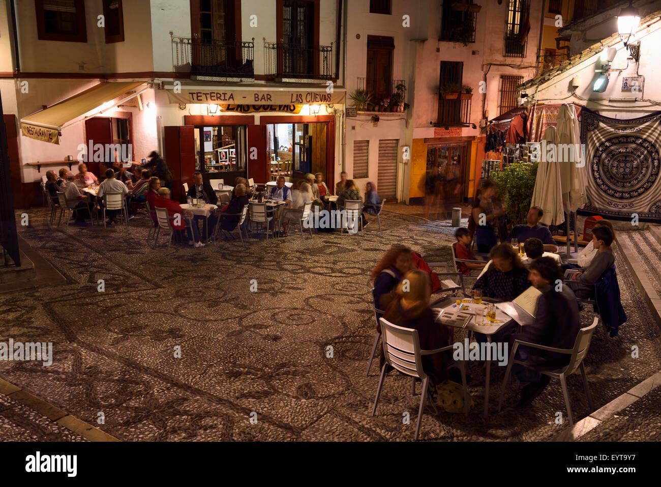 Outdoor patios at night in Plaza San Gregorio on Caldereria Nueva street Granada Stock Photo