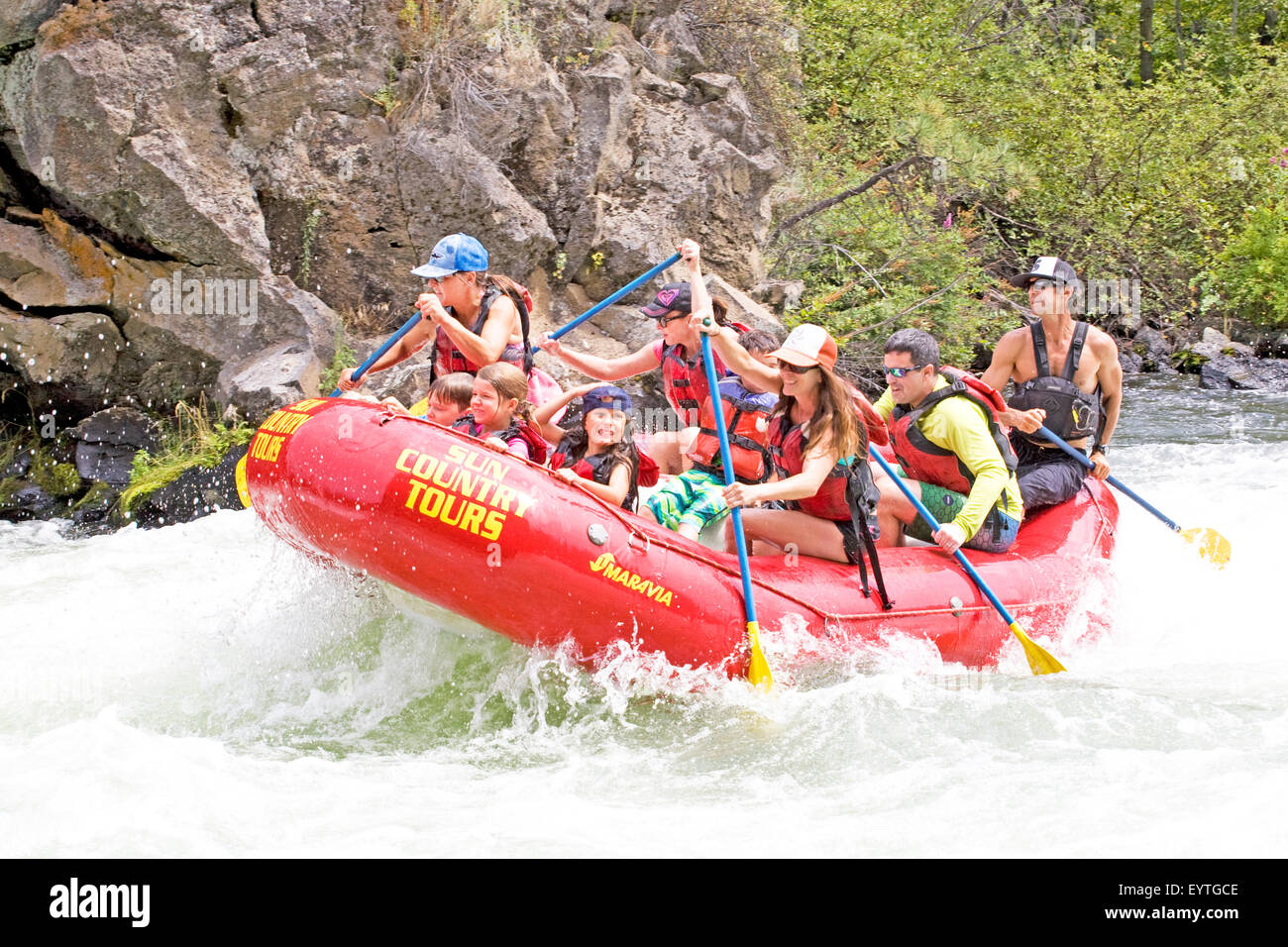 Whitewater rafters during the summer onBig Eddy Falls on the Deschutes River near Bend, Oregon - Stock Image