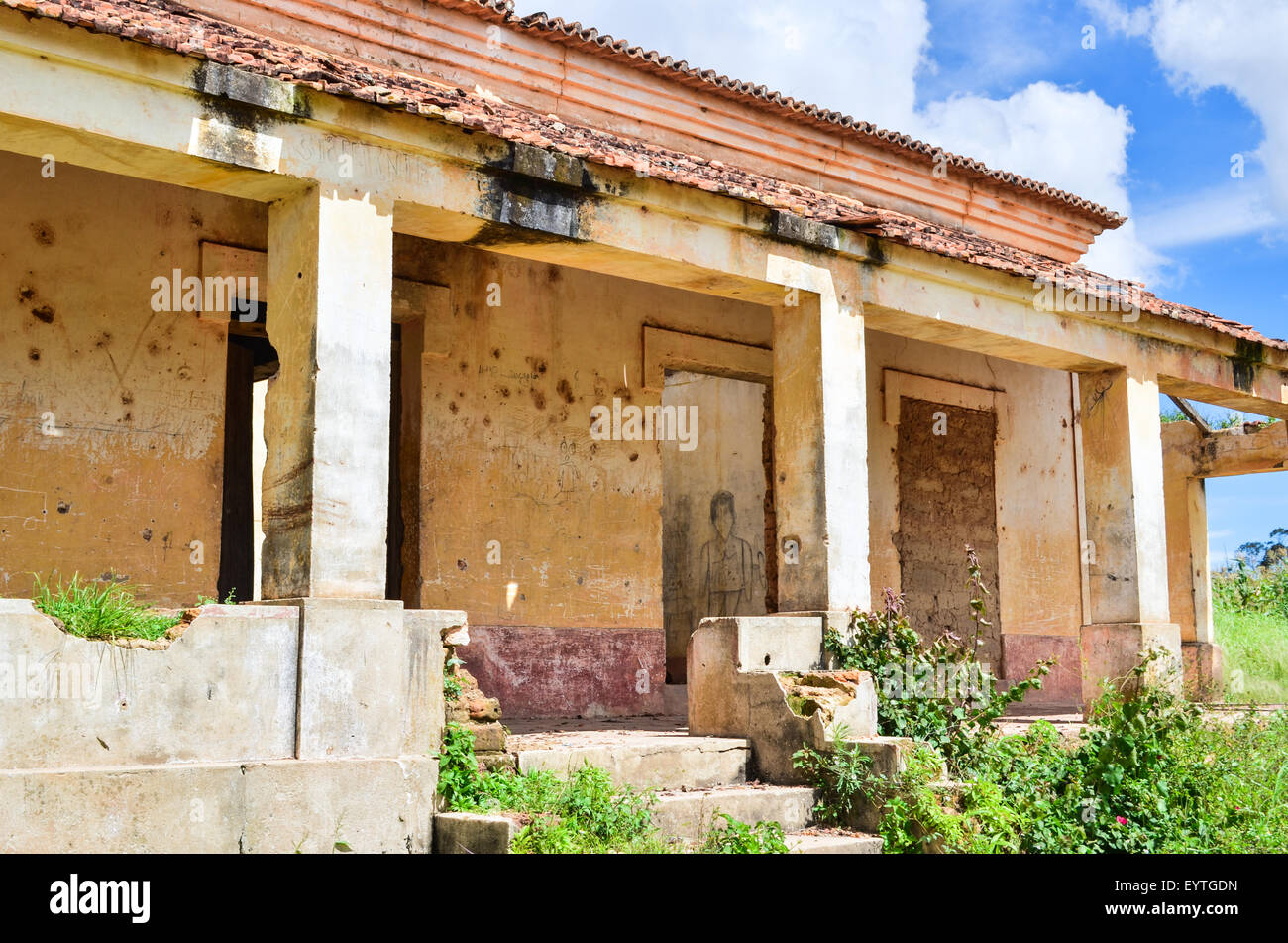 Ruins of a colonial building in rural Angola, with bullet marks in the wall - Stock Image