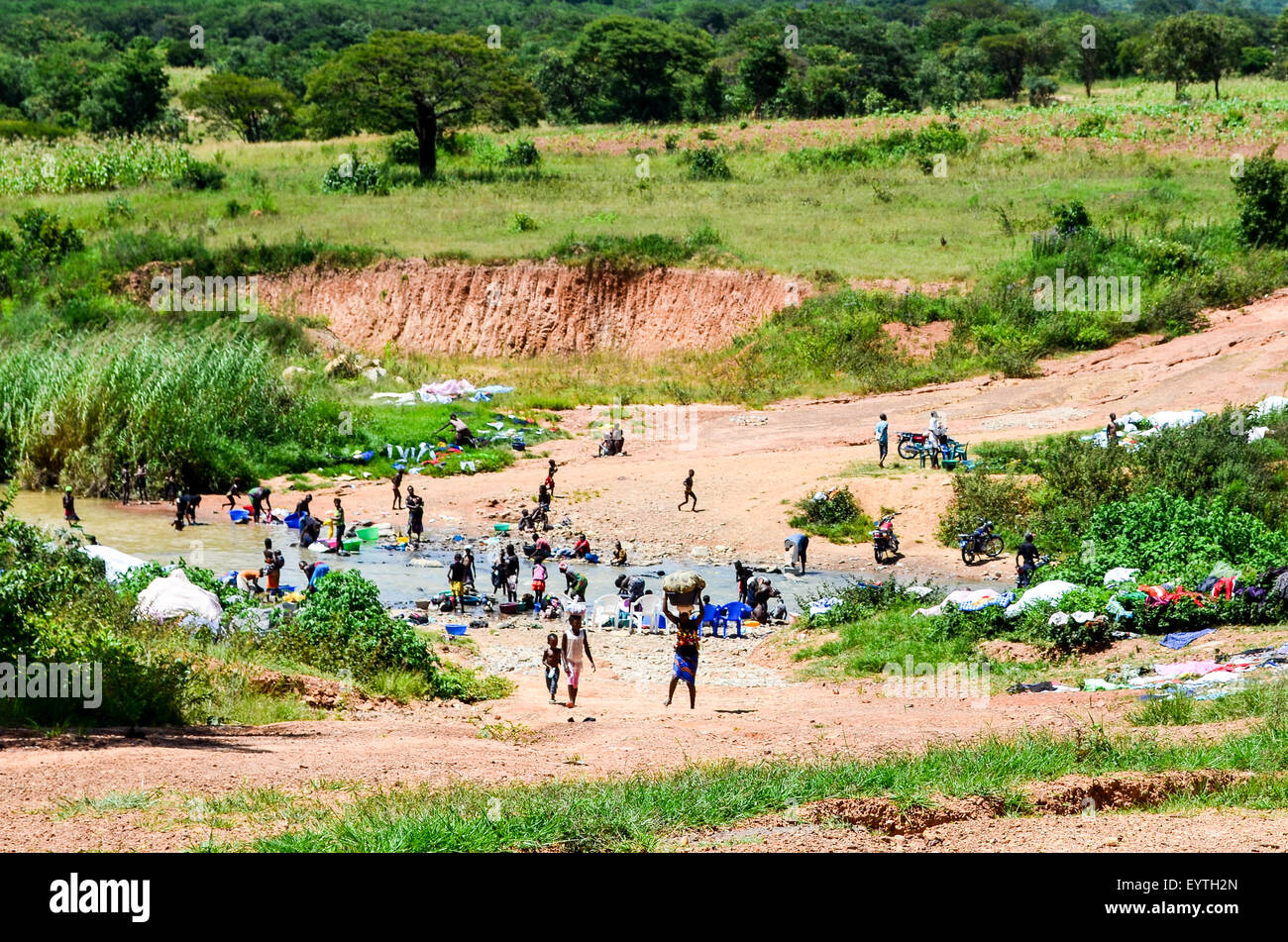 Laundry at the river in Angola - Stock Image