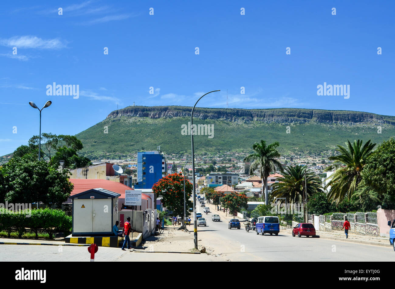 Street view of the city of Lubango, Angola, with mountain and Cristo Rei in the background - Stock Image