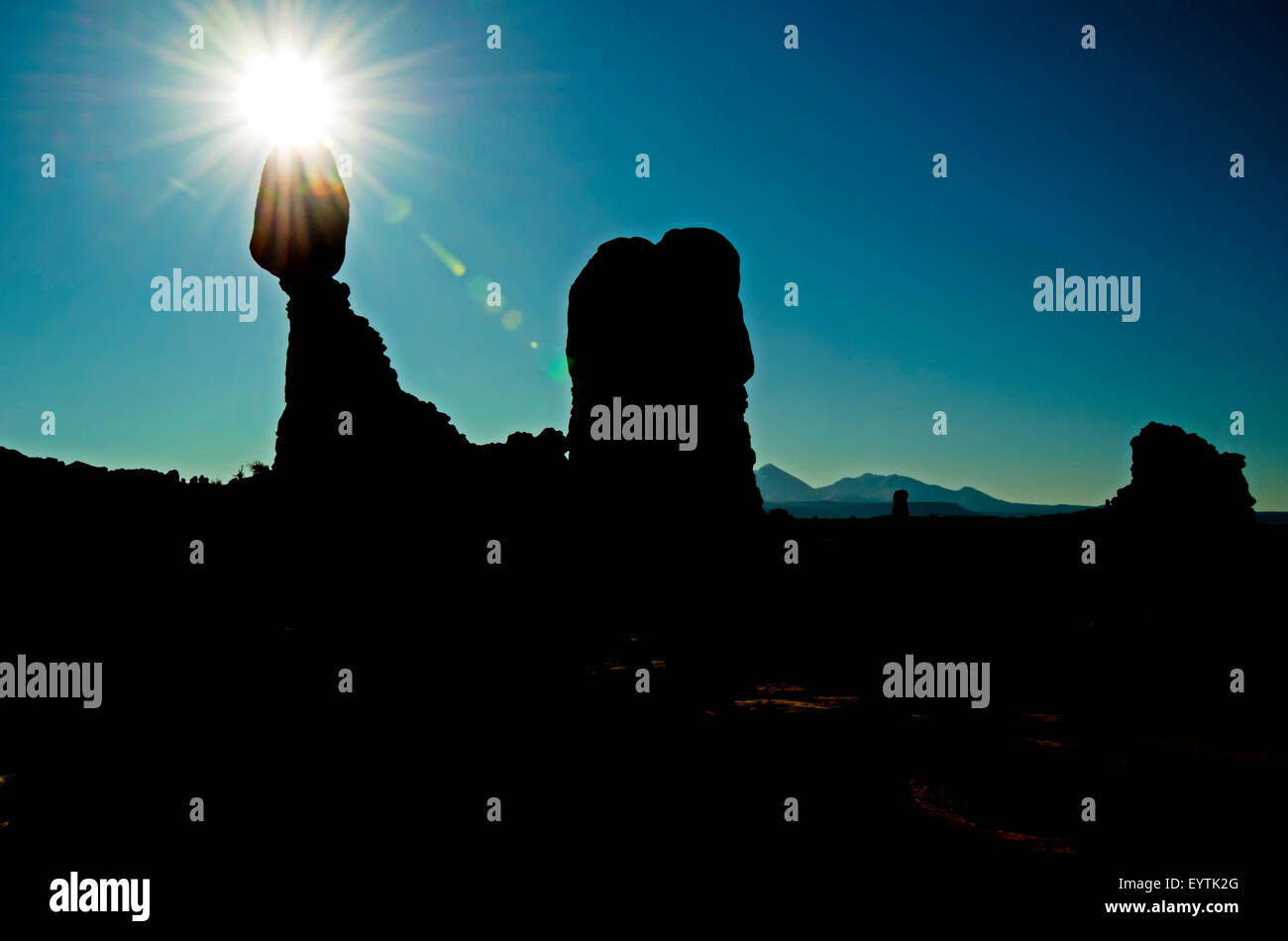 A peaceful artistic silhouetted landscape with the famous 'Balancing Rock' at Arches National Park, Moab, - Stock Image