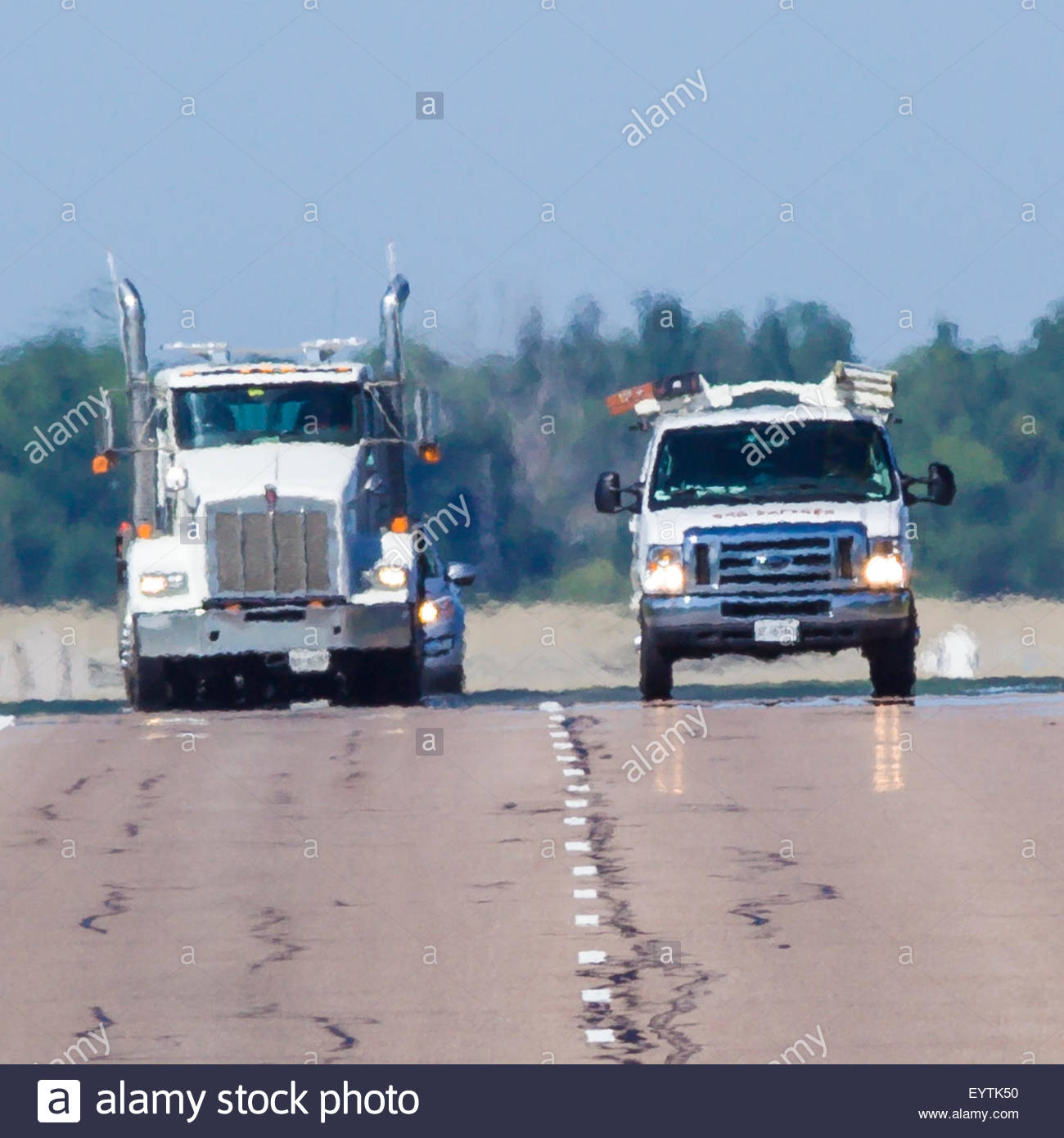 Distortion due to distant heat shimmer on a hot 35 degree Celsius summer day on Highway 407 near Toronto Ontario - Stock Image