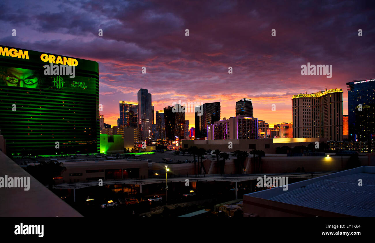 Las Vegas Nevada Skyline at twilight with MGM Grand Hotel and Casino in foreground with vibrant dramatic skies. - Stock Image