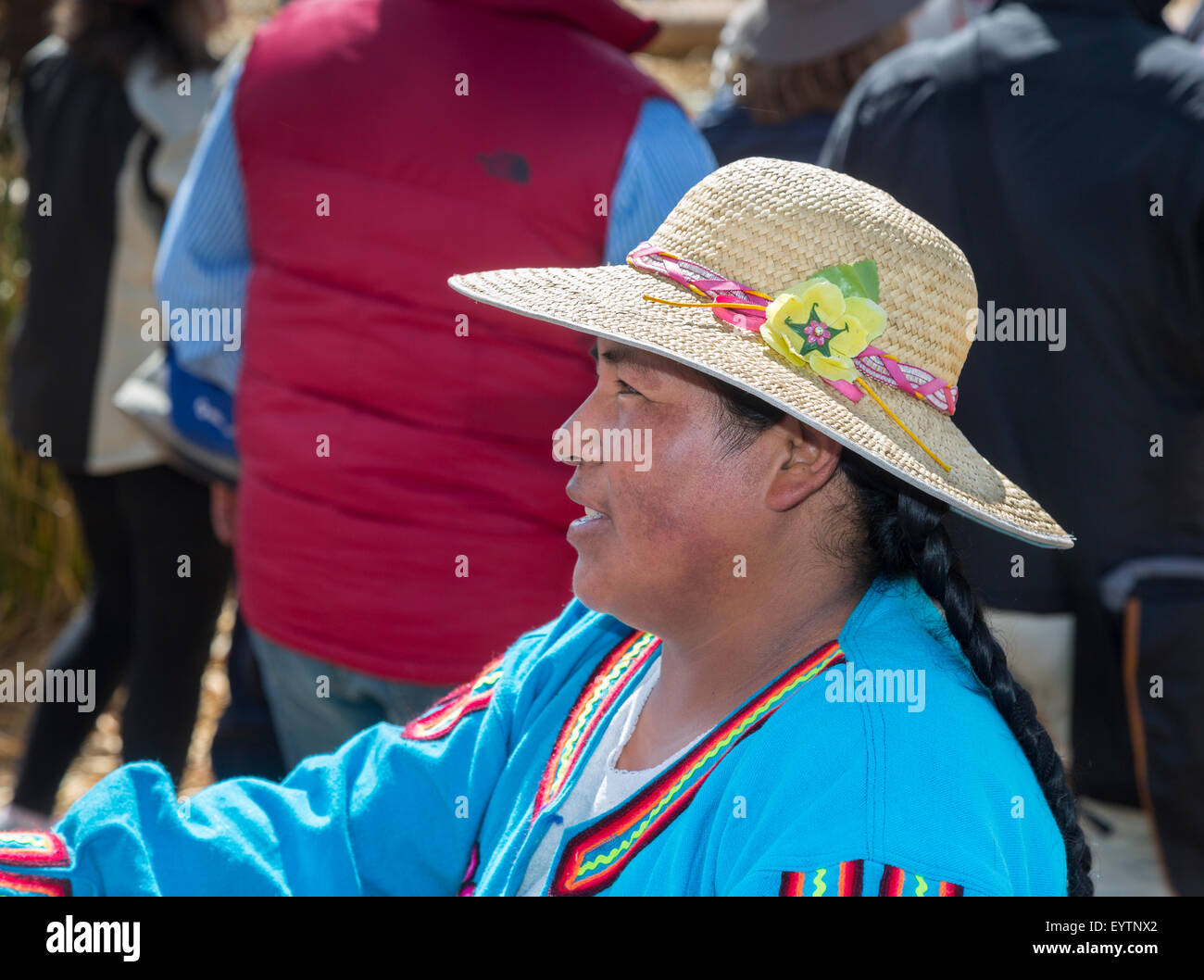 Local Peruvian woman wearing a traditional local style straw hat, Isla Apu Inti, Floating Islands, Lake Titicaca, - Stock Image
