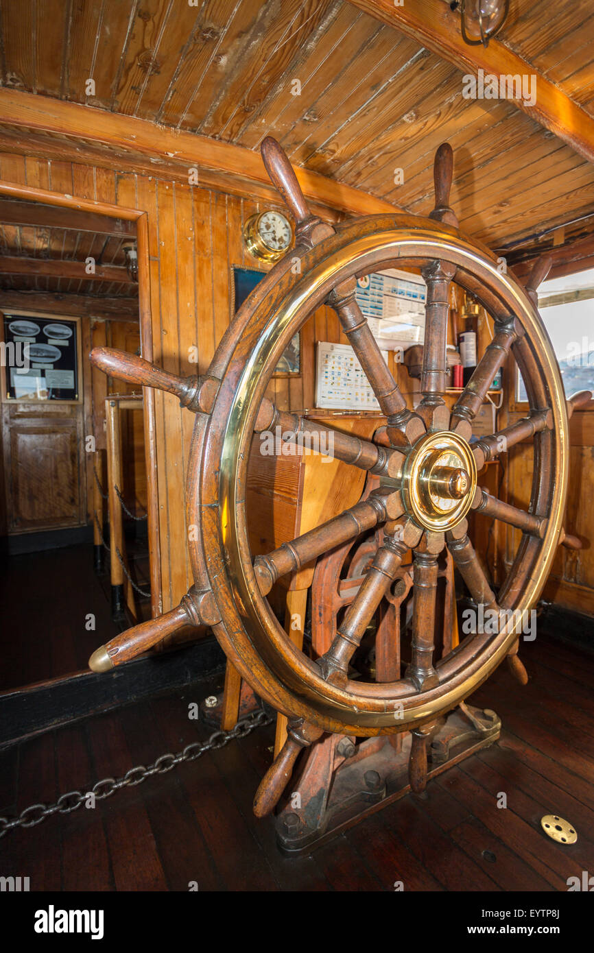 Peruvian heritage: Ship's wheel of the M/V Yavari, a former gunboat, built in West Ham, East London in 1862, - Stock Image
