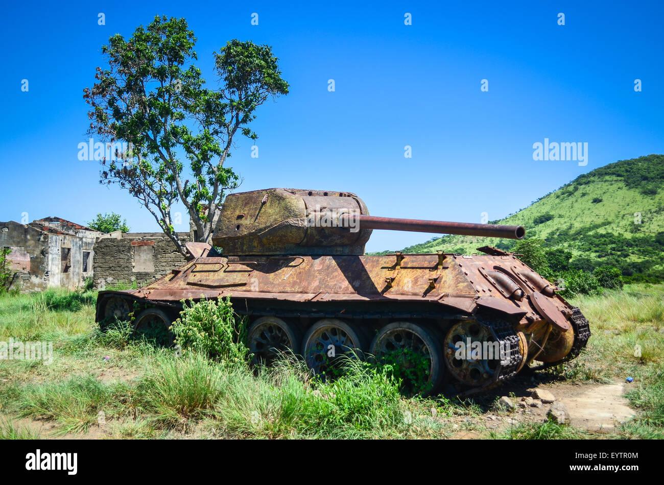 Abandoned rusty tank in Angola, following the civil war - Stock Image