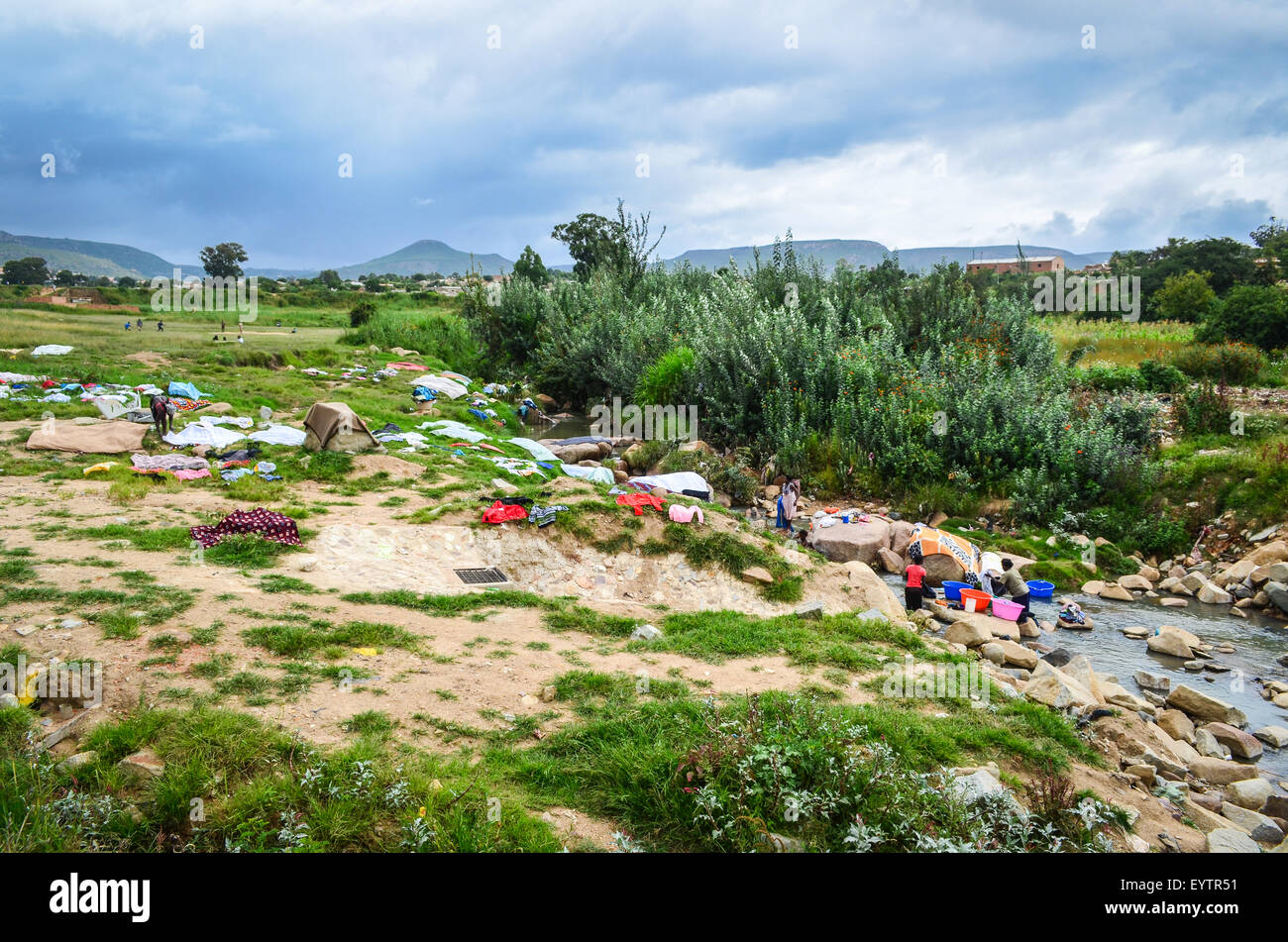 Laundry at the river in Angola (Lubango suburbs) - Stock Image