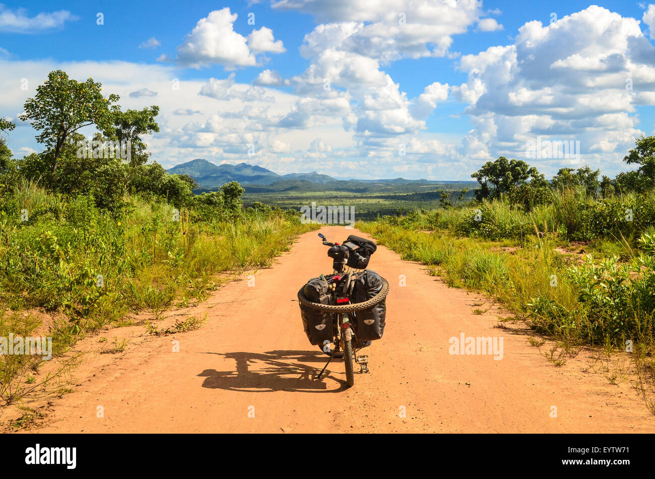Adventure and bicycle touring on the dirt roads of Angola - Stock Image