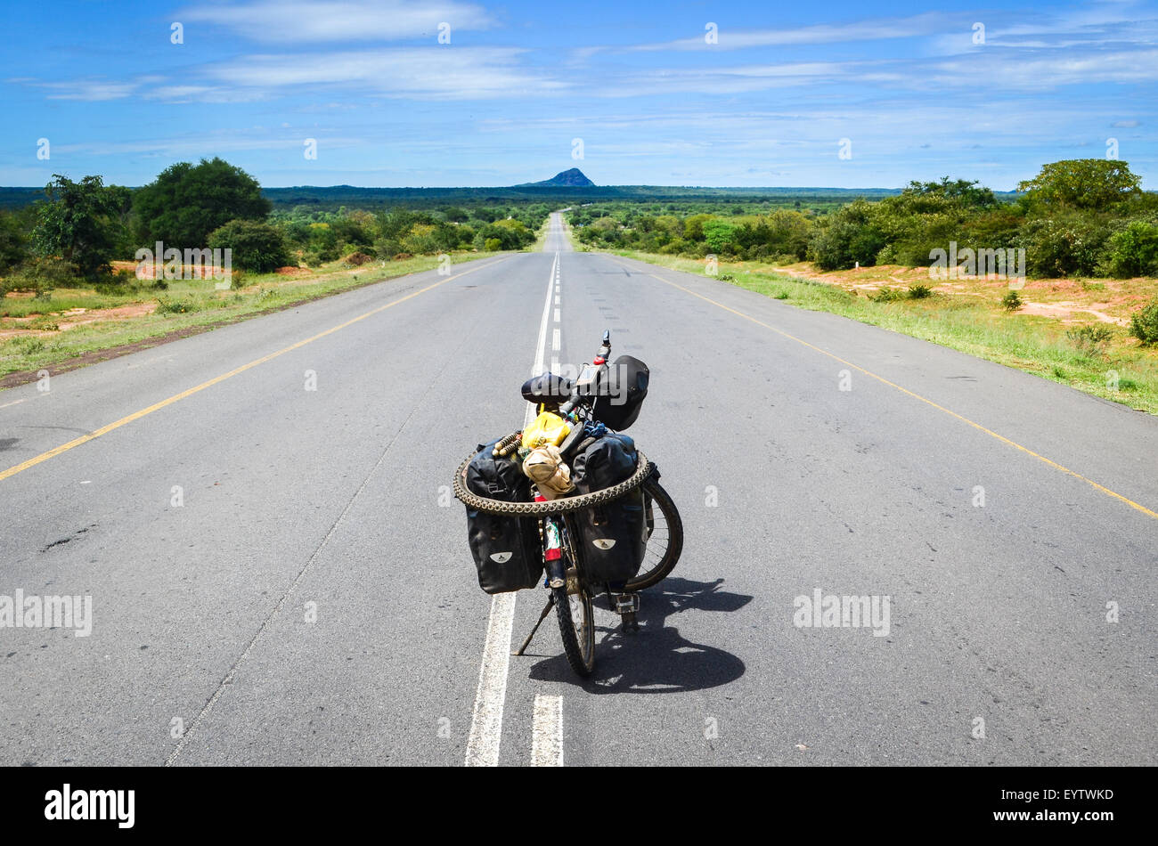 Cycle touring on the tar roads in Angola, Huila province - Stock Image