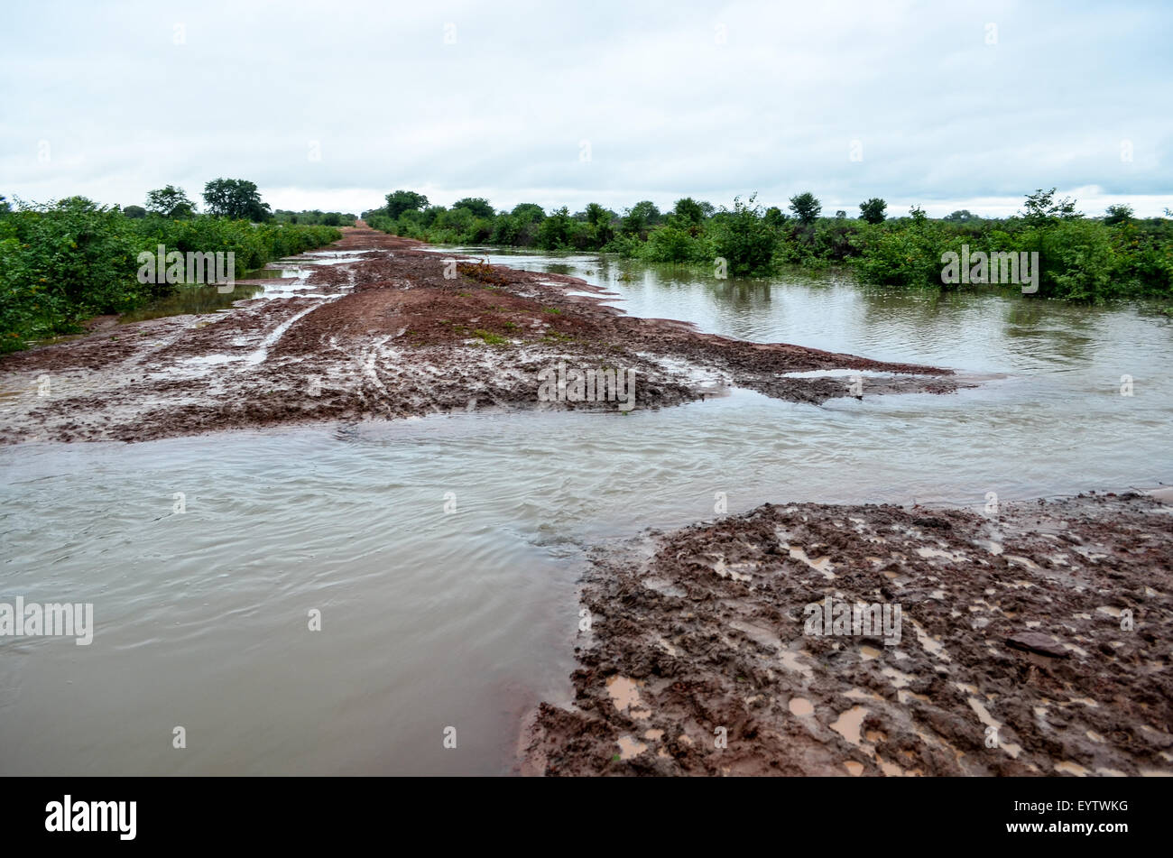 Flooded roads after the rain in Angola and difficulty to travel - Stock Image
