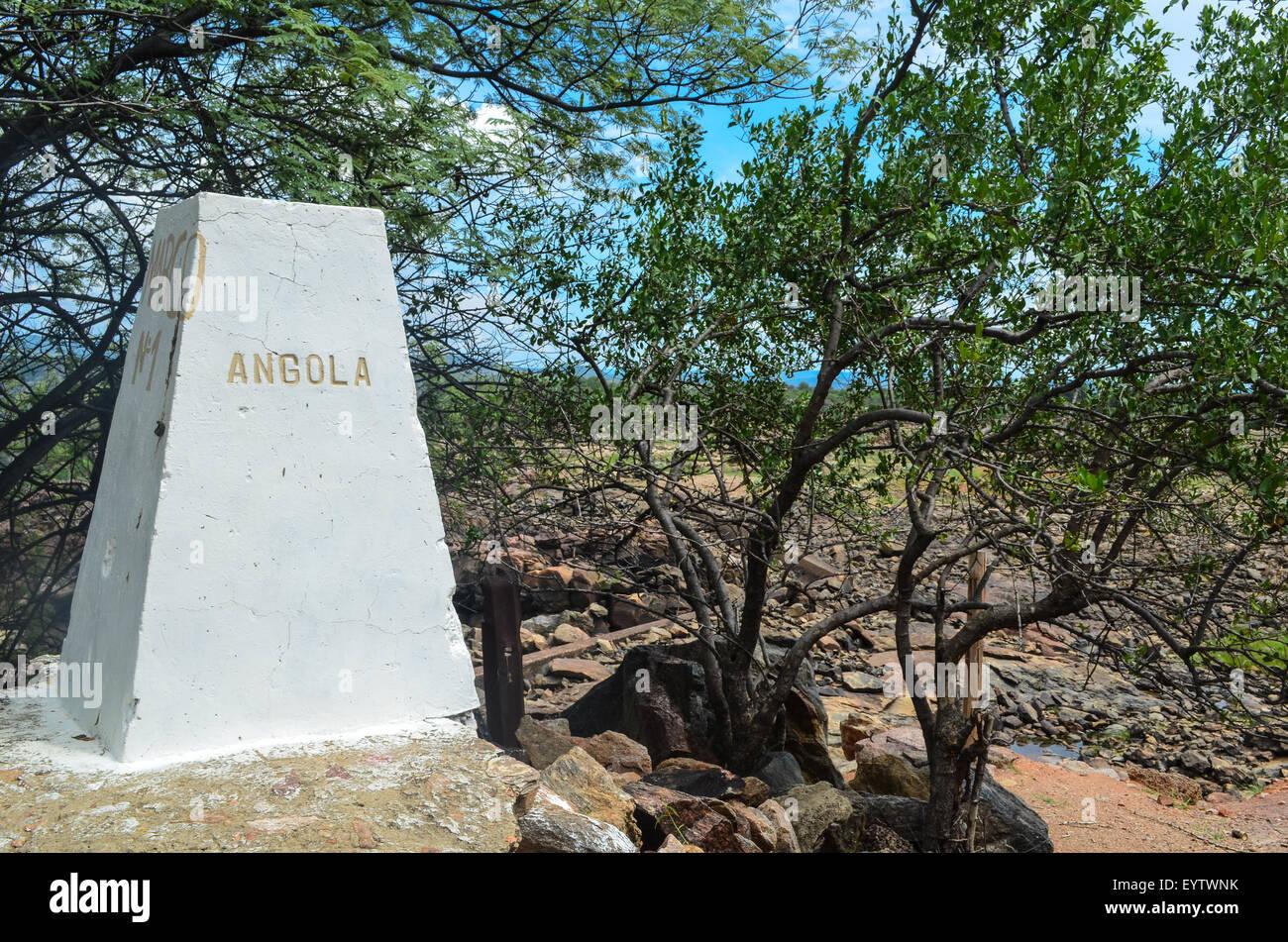 Milestone reading 'Angola' at the Ruacana dam, at the border Angola/Namibia - Stock Image