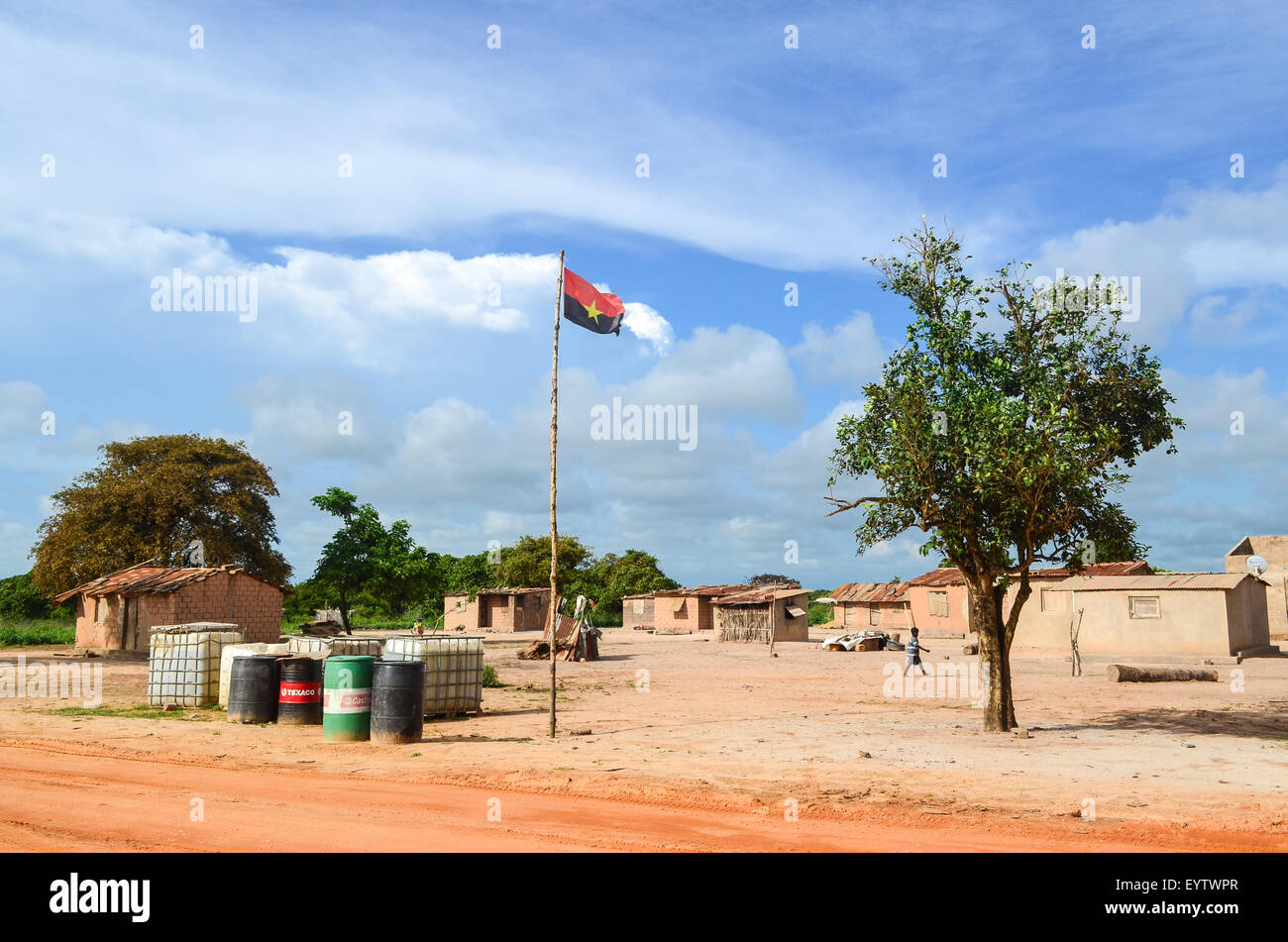 MPLA political party flag in a village in the Zaire province of Angola - Stock Image
