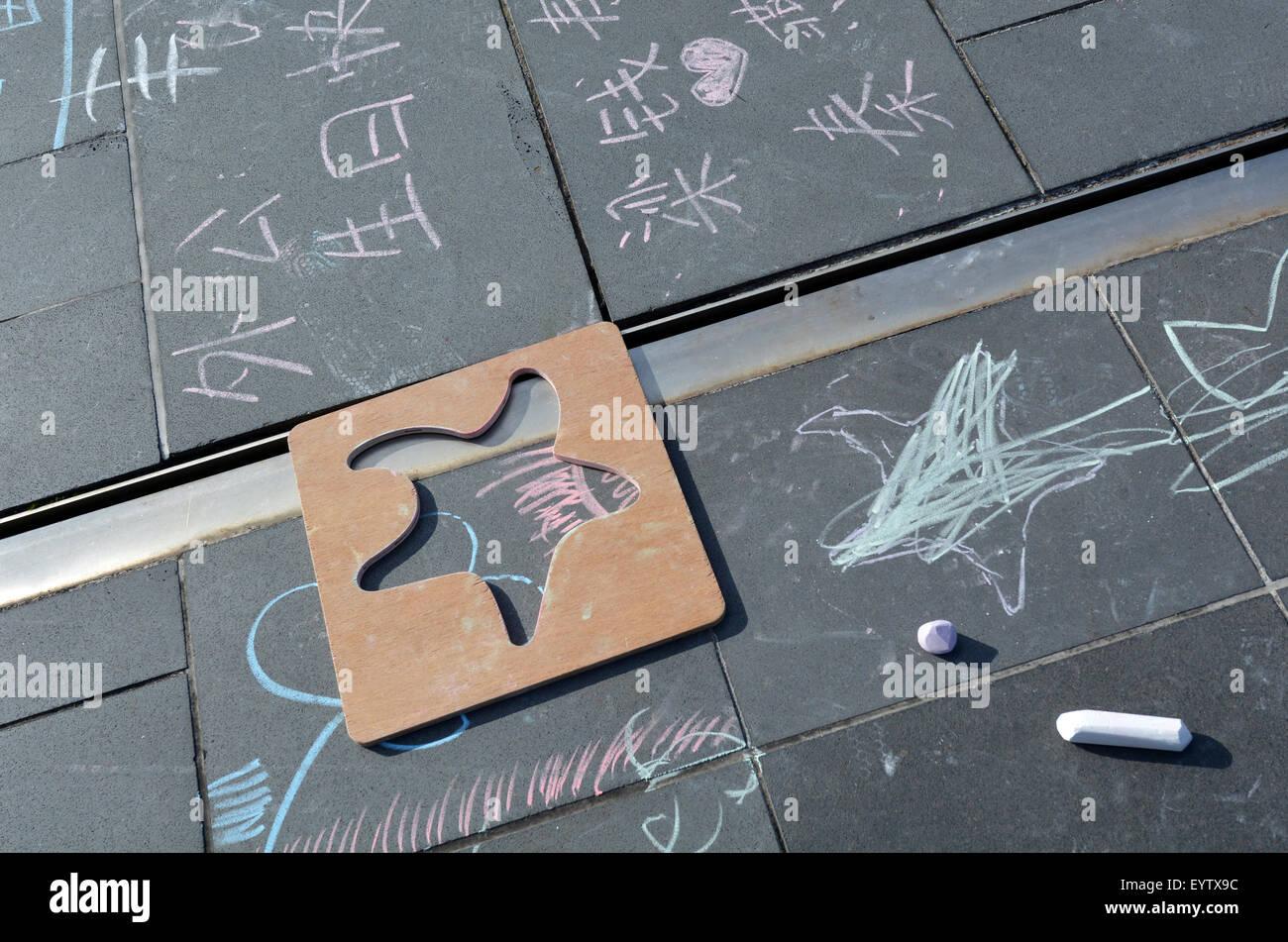 Children chalk drawing on street floor. Childhood concept - Stock Image