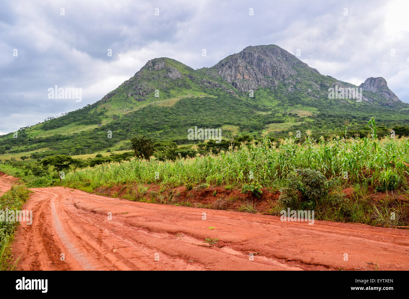 Mountains and dirt red earth road in Angola - Stock Image