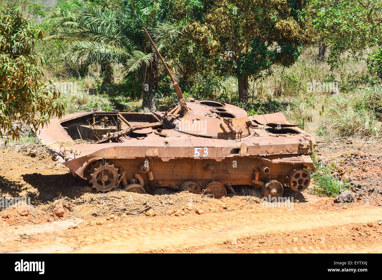 Abandoned rusty tank wreck in Angola, following the civil war - Stock Image
