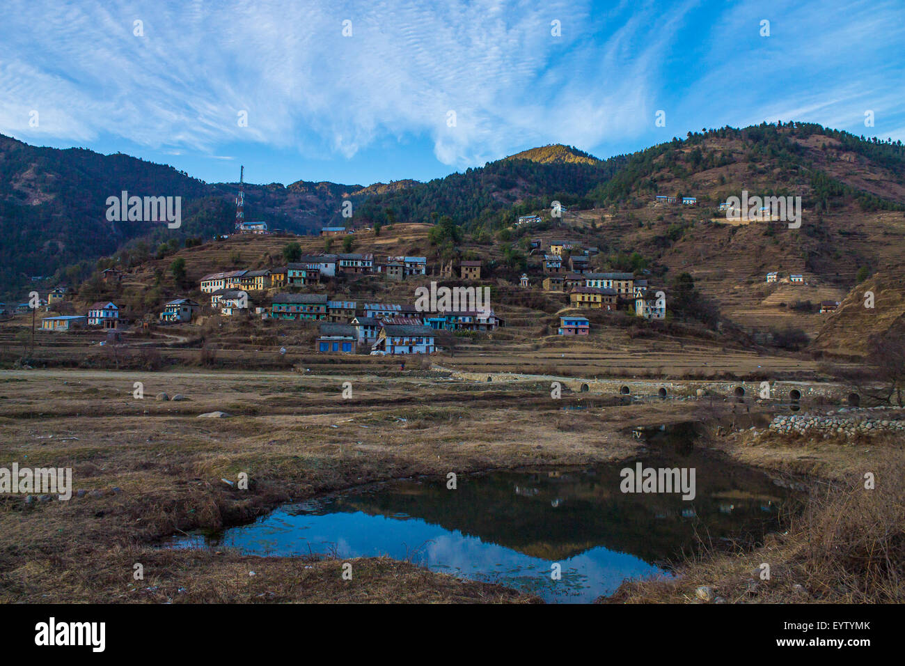 colourful houses and reflection in a Nepalese hill village in Palung, Nepal - Stock Image