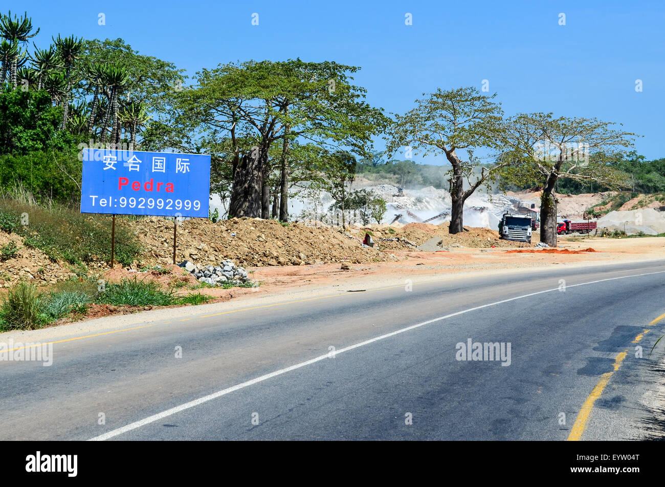 Chinese quarry by a tar road near Caxito in Angola - Stock Image