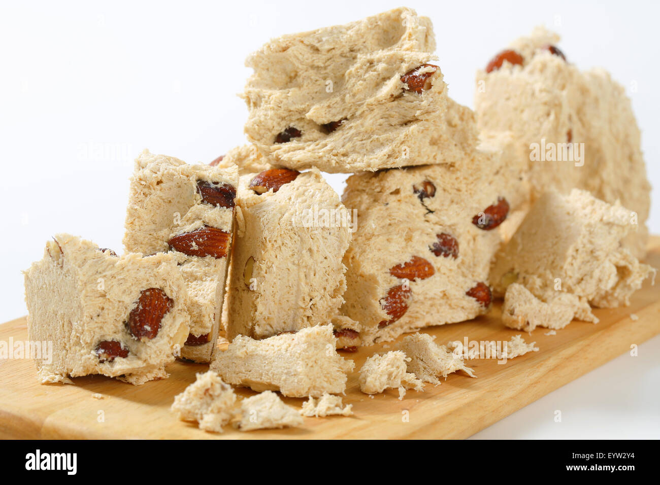 Pieces of Greek halva with almonds - Stock Image