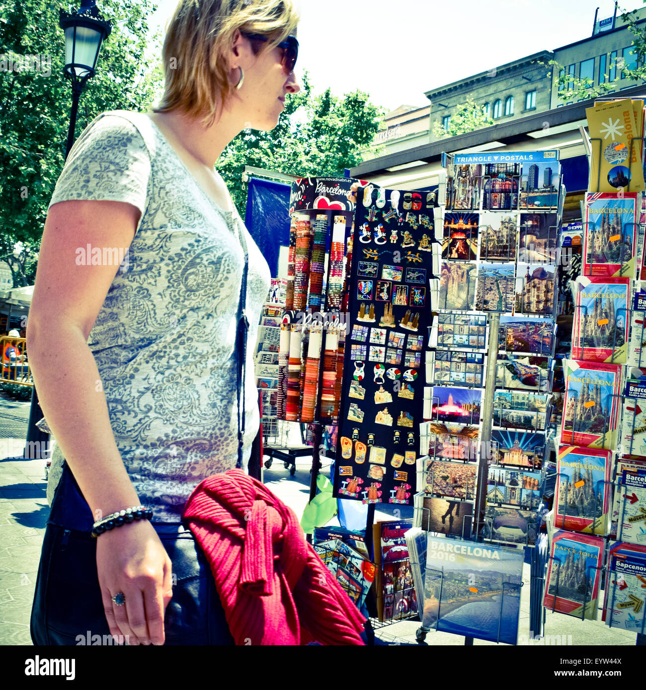 Woman and postcards. Barcelona, Catalonia, Spain. - Stock Image