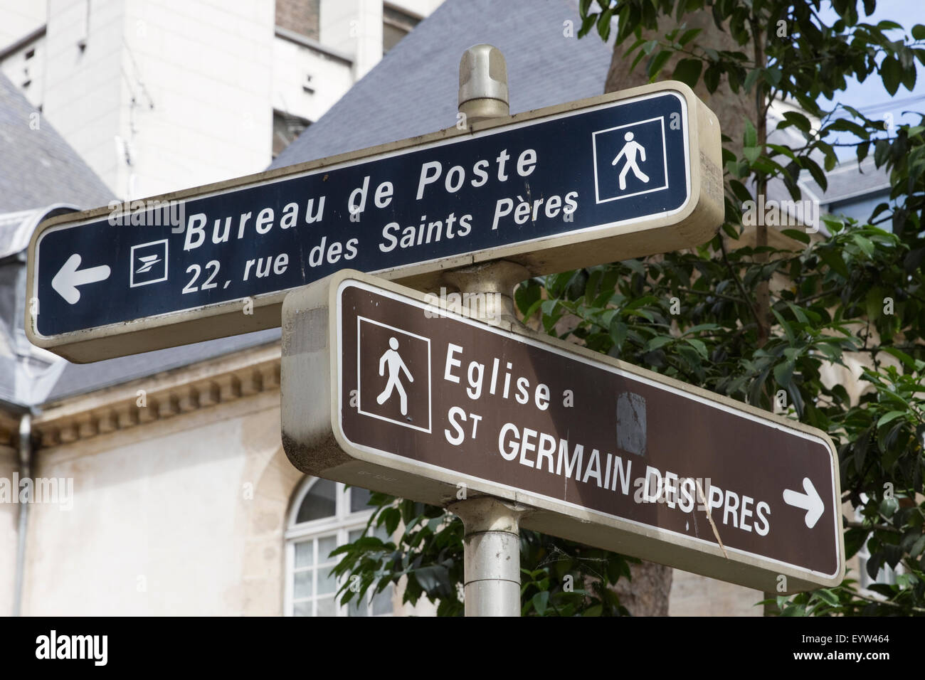 Street signs for the Abbey of Saint-Germain-des-Prés and Bureau de Poste in Paris, France. - Stock Image