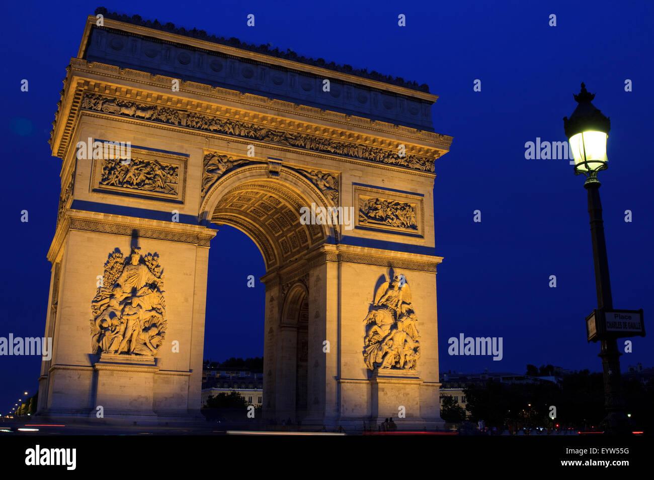 Arc de Triomphe de l'Étoile at blue hour as seen from The Avenue de la Grande Armée/Place Charles - Stock Image