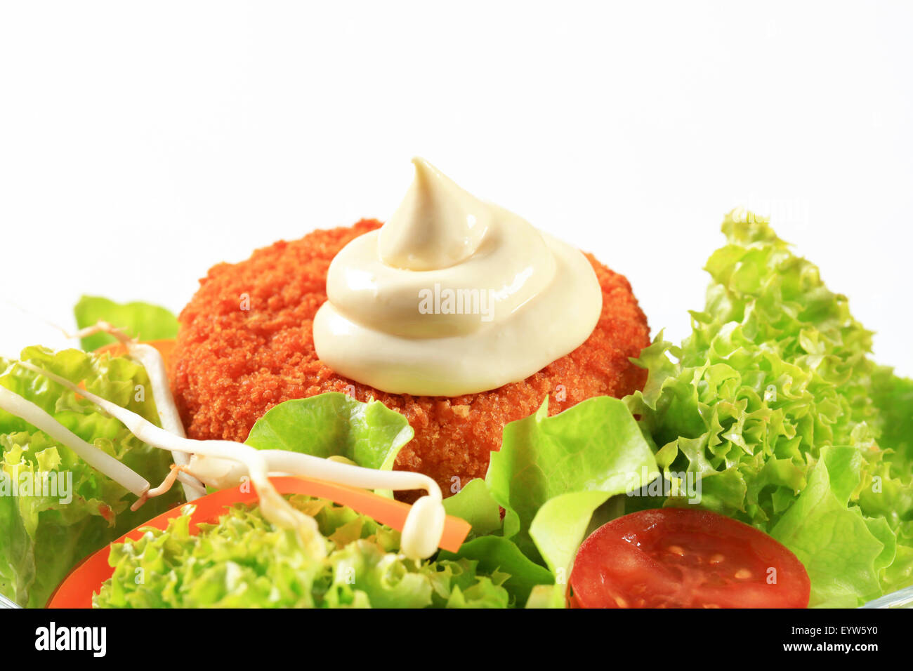 Green salad with fried breaded cheese and mayonnaise - Stock Image