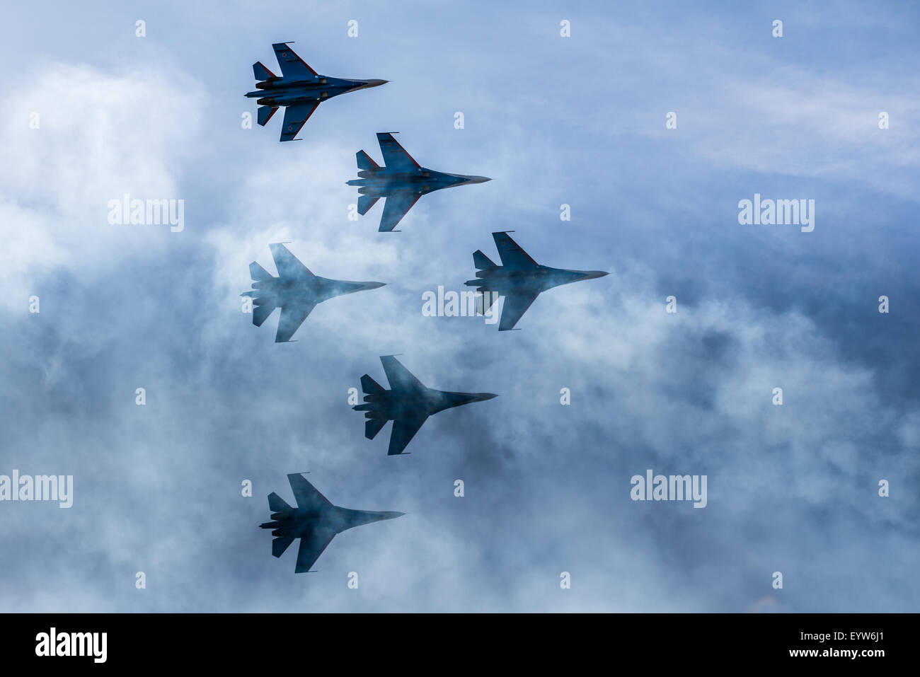Silhouettes of russian fighter aircrafts SU-27 in the sky - Stock Image