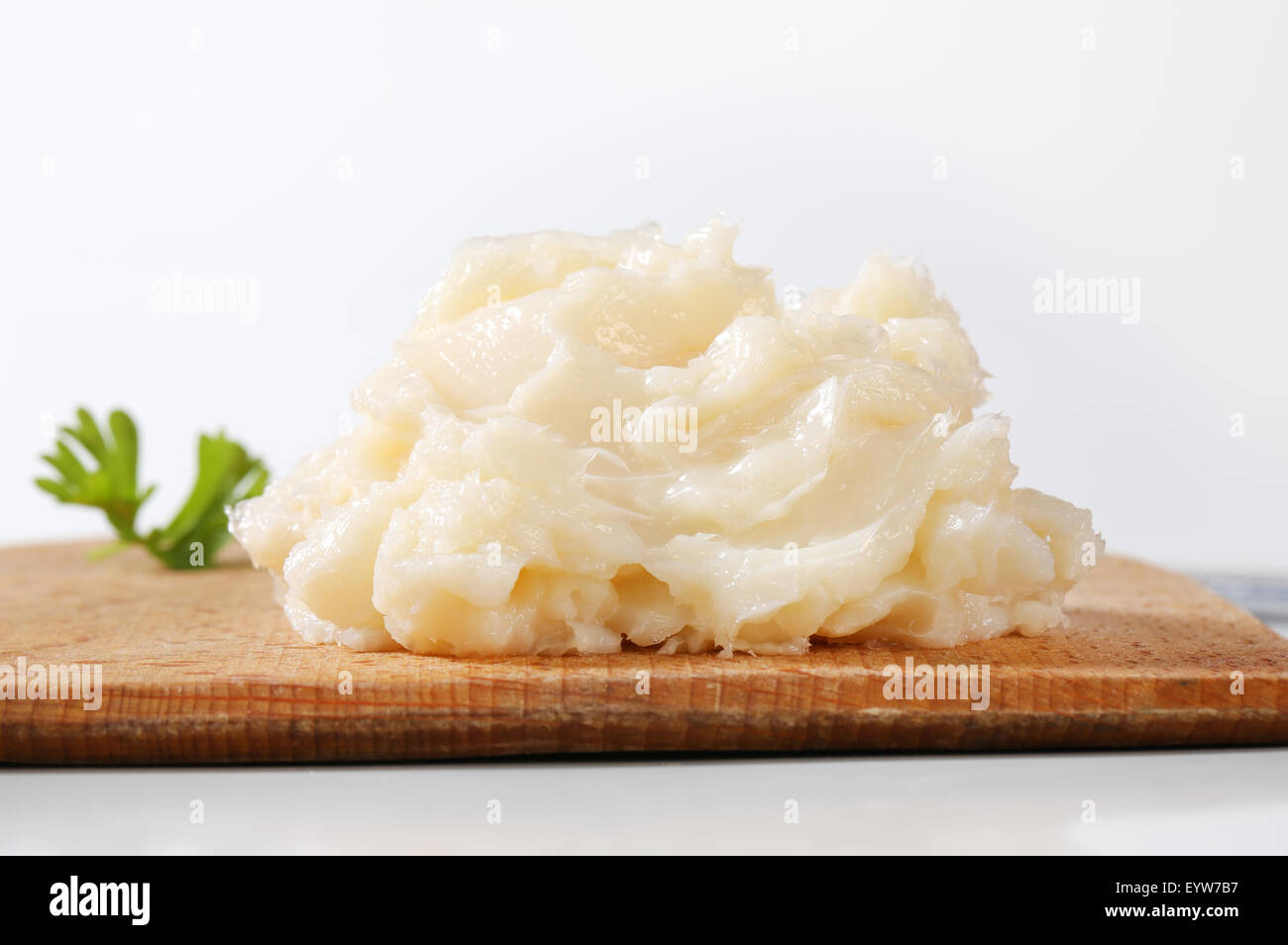 Pork lard spread on cutting board - Stock Image
