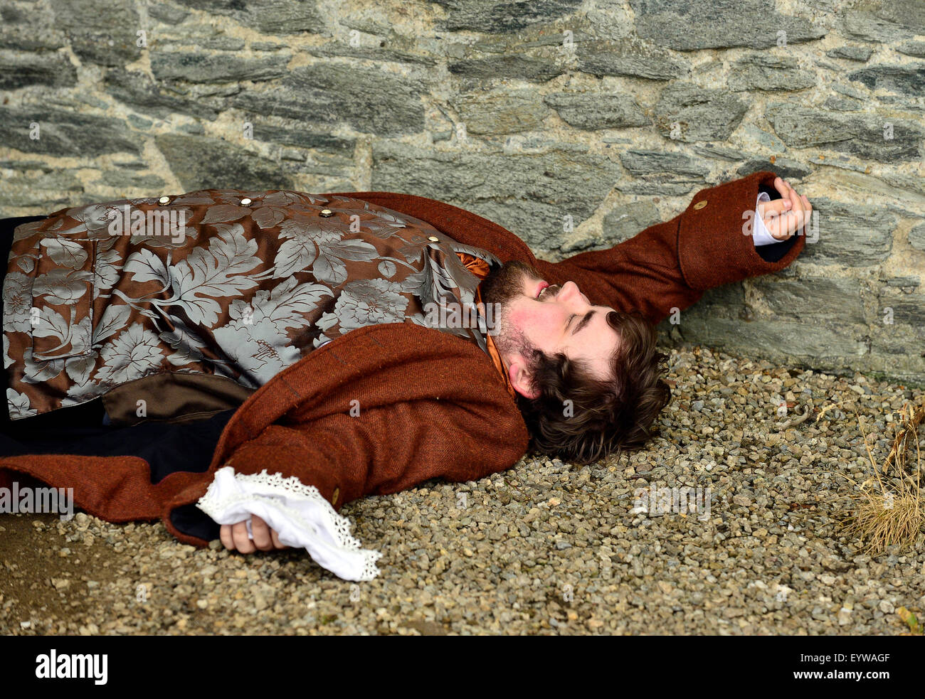 Actor plays a dead citizen in a re-enactment of scene from the Siege of Derry (1688-1689) on Derry Walls during - Stock Image