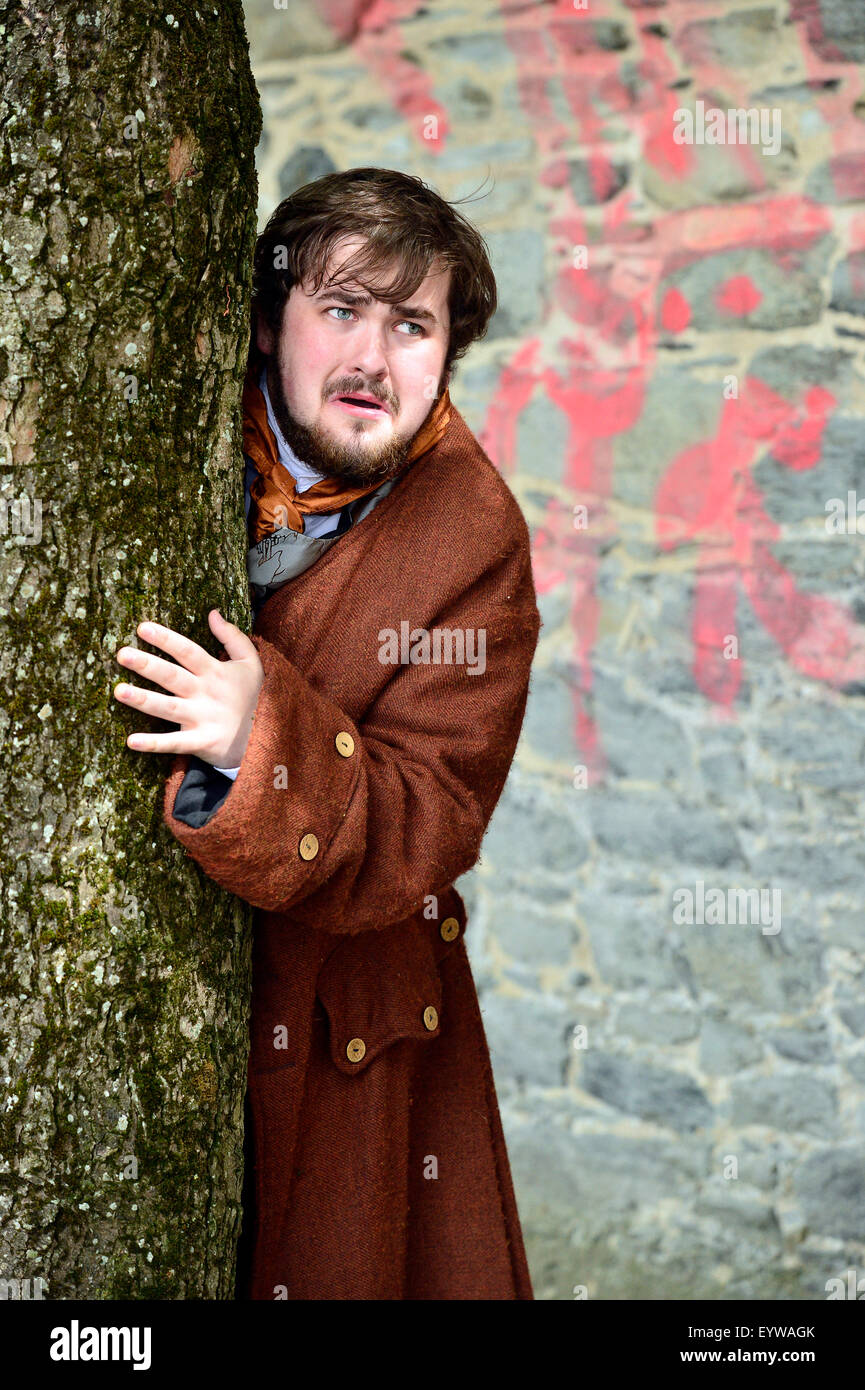 Actor plays a fearful citizen in a re-enactment of scene from the Siege of Derry (1688-1689) on Derry Walls during - Stock Image