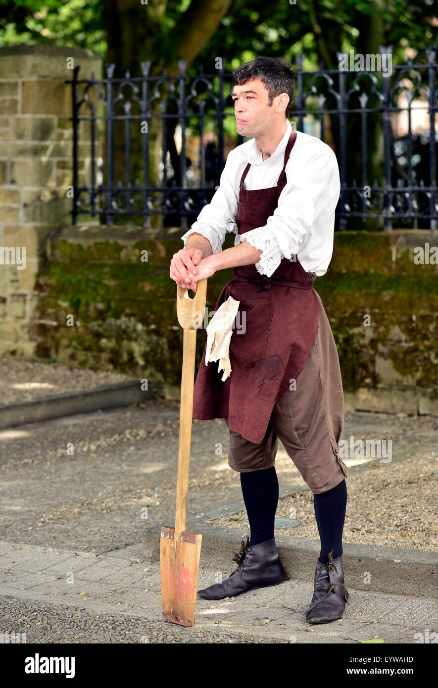 Actor plays a grave digger in a re-enactment of scene from the Siege of Derry (1688-1689) on Derry Walls during - Stock Image