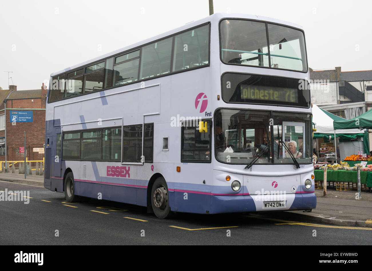A First Essex group bus loads passengers in Jackson Road Clacton Essex. The buses is a Volvo B7TL with Alexander - Stock Image