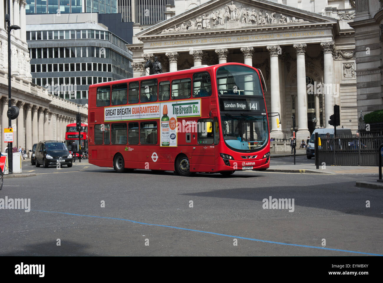 An Arriva London Volvo B5LH With Wrightbus Eclipse Gemini 2 bodywork passes in front of the Corn Exchange building - Stock Image