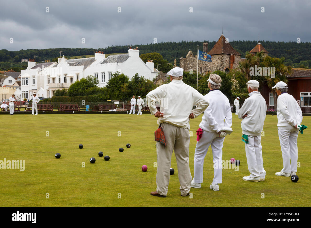 Senior men and women of Sidmouth Bowls Club playing bowls. Stock Photo