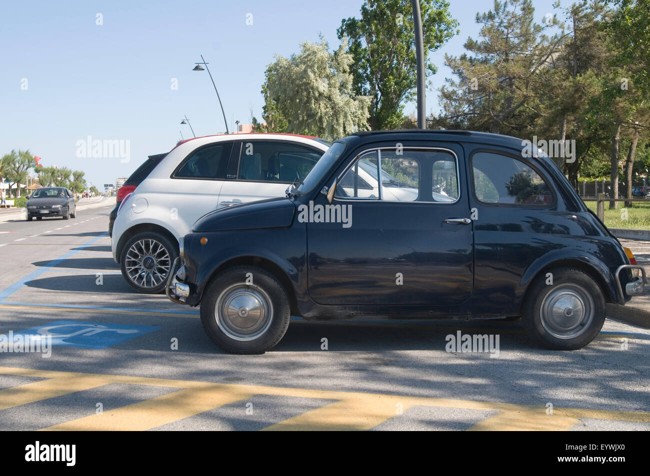 fiat 500 old new size classic modern comparison huge big bigger car cars getting tiny small city wheel wheels - Stock Image