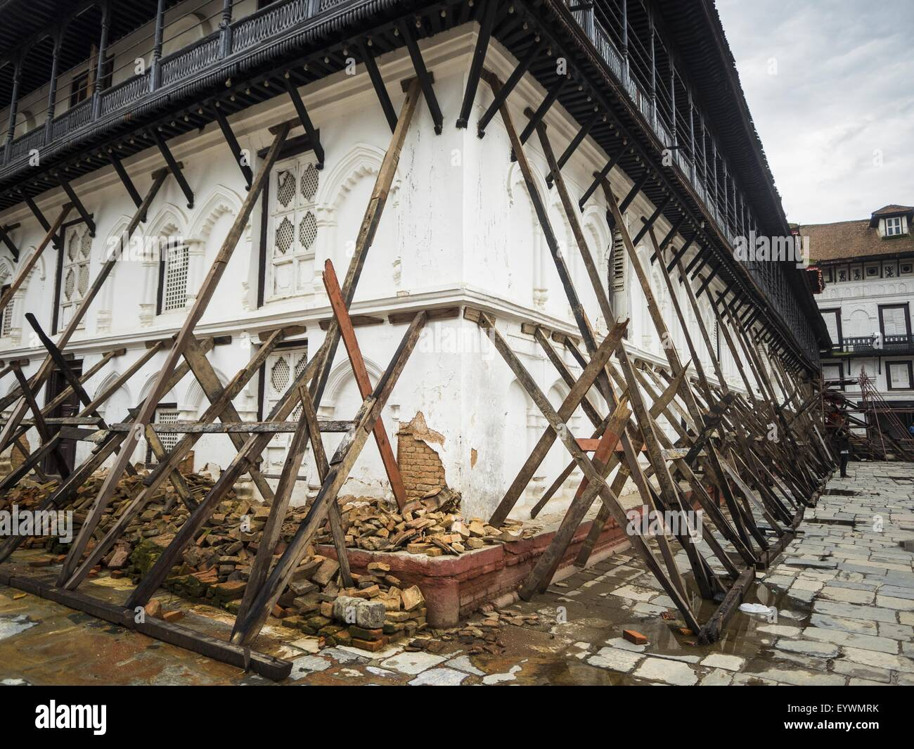 July 30, 2015 - Kathmandu, Nepal - Walls of the Sundari Chowk propped up with timbers after the earthquake in Durbar - Stock Image