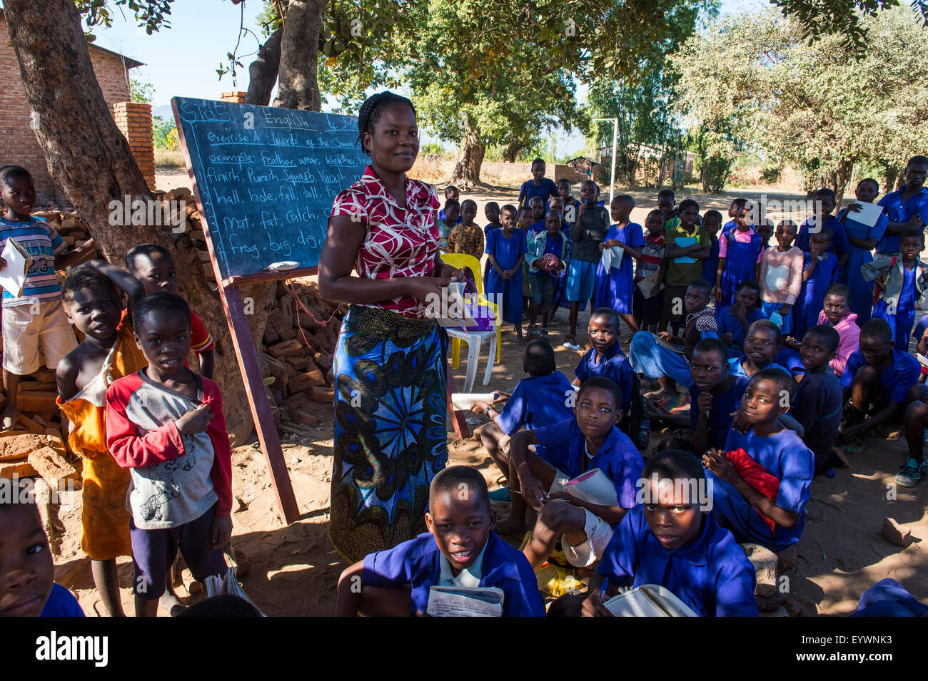 Primary school on a dusty street with many children, Liwonde National Park, Malawi, Africa - Stock Image