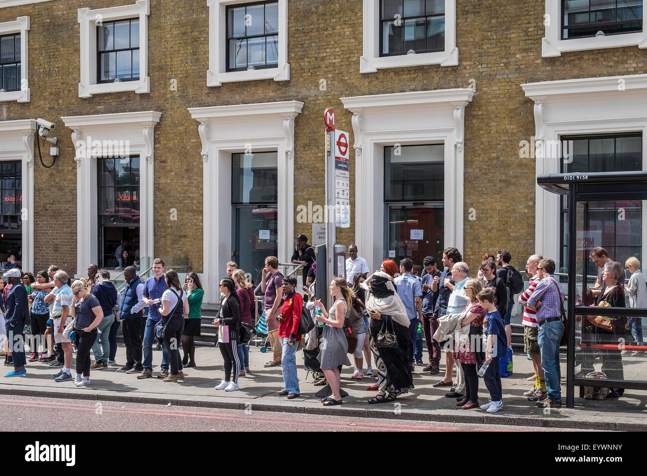 People waiting for a bus in Southwalk, London. Stock Photo