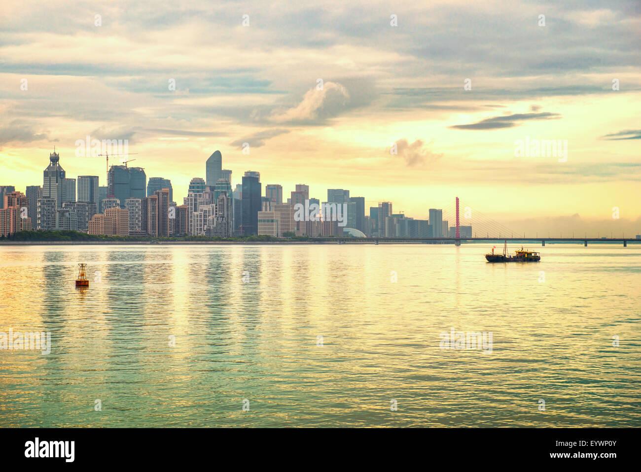 Ever-developing Jianggang skyline and Qianjiang River in Hangzhou, Zhejiang, China, Asia - Stock Image